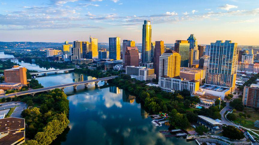 Austin Texas USA sunrise skyline cityscape over Town Lake or Lady Bird Lake with amazing reflection.