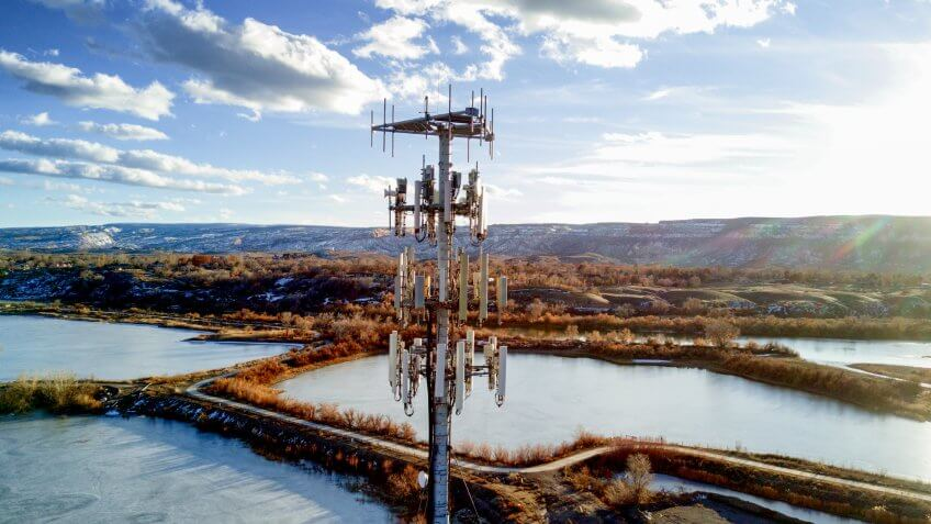 Beautiful shot of a modern cellular phone tower in a pretty setting with beautiful clouds.