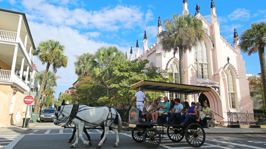 Charleston, South Carolina USA - October 12, 2015Horse Drawn Carriage Ride by French Huguenot Church.