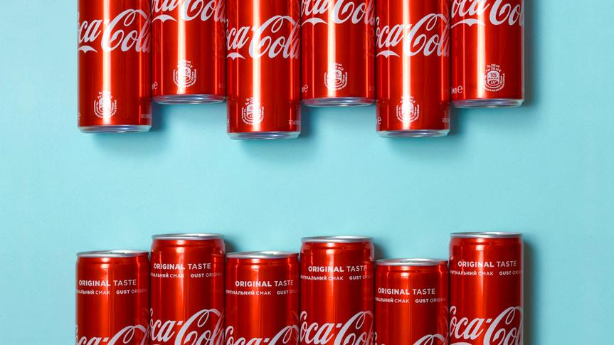 Flat lay shot carbonated red drink tin cans Coca Cola laying on pastel blue background - Image.