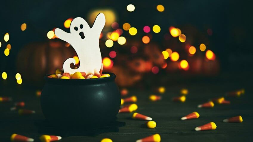 Halloween still life with ghost in cauldron.