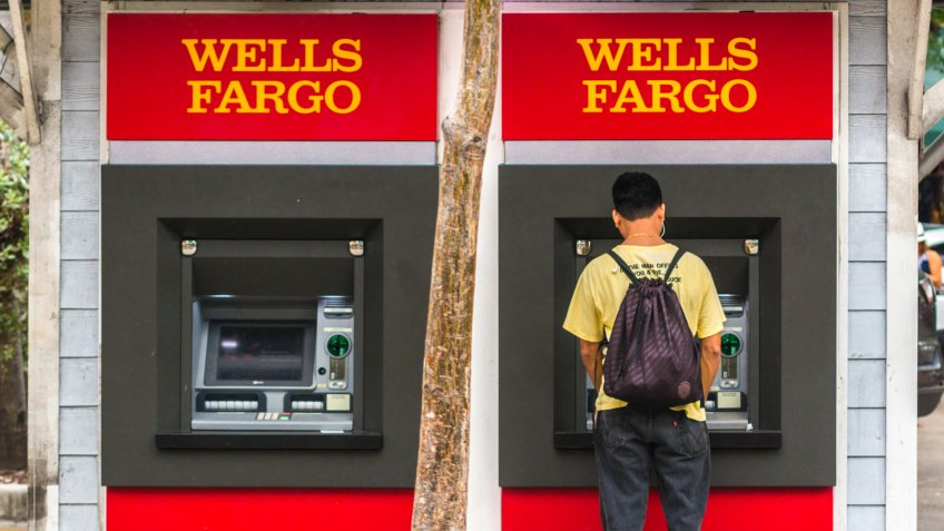Key West, USA  - January 9, 2015: Man using Wells Fargo ATM on Duval street, Key West.
