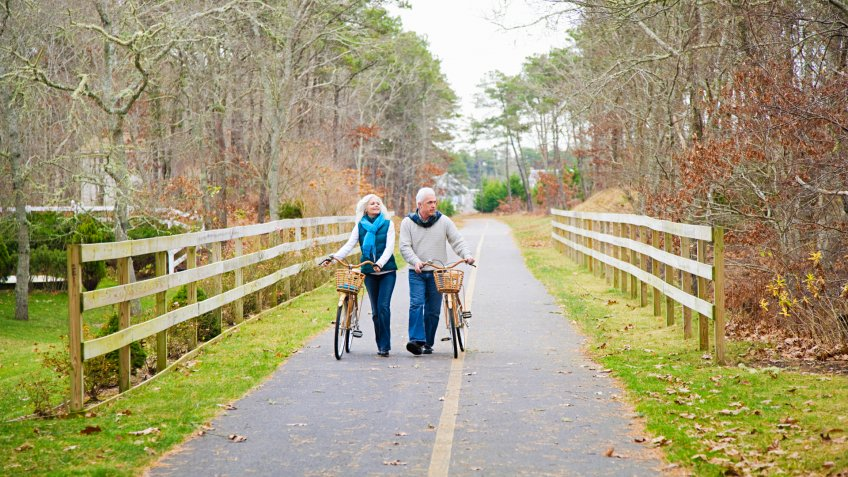55 to 59 years, 60 to 64 years, Autumn, Bicycle, Cape Cod, Caucasian, Cycling, Female, Fence, Full Length, Healthy lifestyle, Horizontal, MAN, Male, Massachusetts, Mature Couple, Outdoors, Photography, Retirement, Tree, chatham, color, cross-media, cycle path, day, heterosexual couple, leisure, mature man, path, rural, senior woman, togetherness, two people, vacation, walking, winter, woman