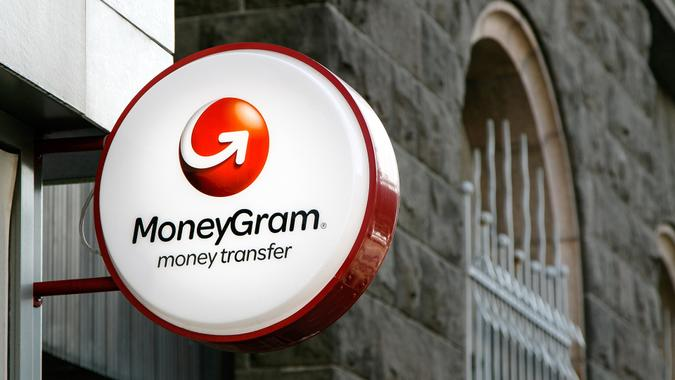 Reykjavik, Iceland, August 22, 2017: MoneyGram sign is mounted to a wall above the entrance to their branch.