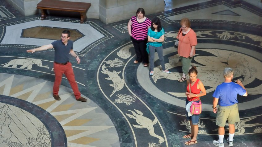 Lincoln, Nebraska, USA - July 9, 2013: People on a tour of the beautiful Nebraska State Capitol in Lincoln.