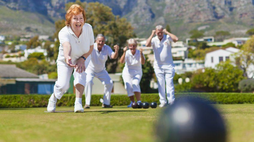 60-64 Years, 70-74 years, Accuracy, Active Seniors, Aiming, Arms Outstretched, BALL, Cape Town, Caucasian, Color Image, Competition, Crouching, Excitement, Focus On Background, Full Length, Fun, Grass, Horizontal, Lawn, Low Angle View, MAN, Other Keywords, Outdoors, People, Photography, Playing, ROLLING, Recreation, Retirement, Senior Adult, Senior Men, Senior Women, Smiling, South Africa, Standing, Sunny, Surface Level, TEAM, Teamwork, Throwing, Weekend Activities, active, aging, bending, bowles, bowling, challenge, concentration, day, enjoying, exercise, fitness, focus, focusing, four people, friend, front view, happy, healthy living, lawn bowling, leisure activity, lifestyle, motion, mountain, nature, physical fitness, precision, sports, together, vitality, woman