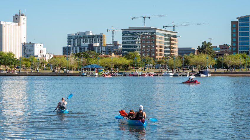 People in rental boats enjoy a sunny day on Tempe Town Lake in Arizona.
