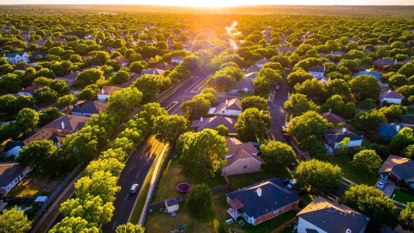 Brushy Creek Suburb Homes above Neighborhood in Austin , Texas suburb of Round Rock , TX aerial drone view high above Texas Hill Country houses golden hour sunset sun rays and lens flare - Image.