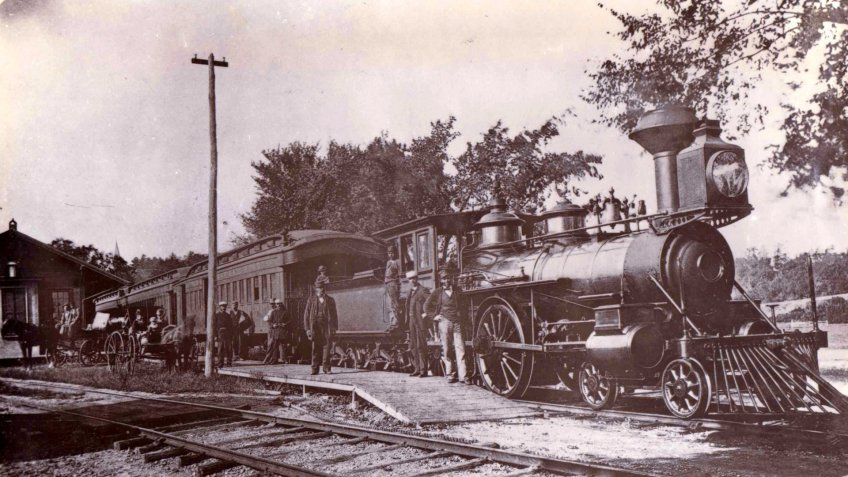 A train at the Saxonville railway station in 1880