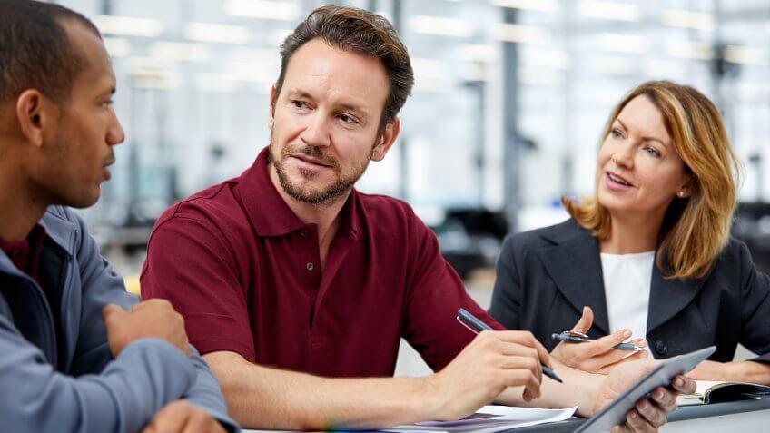 car dealer associate talking with customer