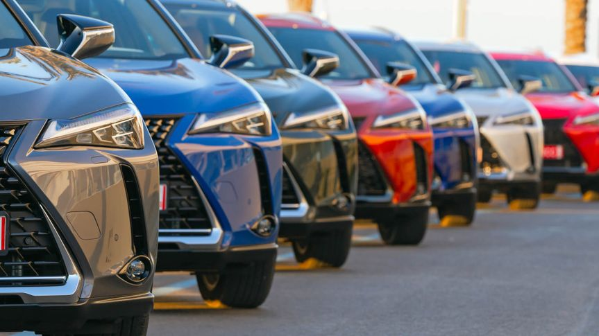Sitges, Spain - 26th February, 2019: Lexus UX (Toyota Group) SUV vehicles in hybrid version parked on the public parking before the drives.