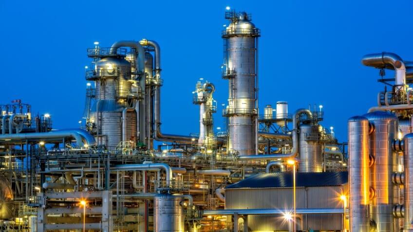 Petrochemical plant illuminated at twilight.