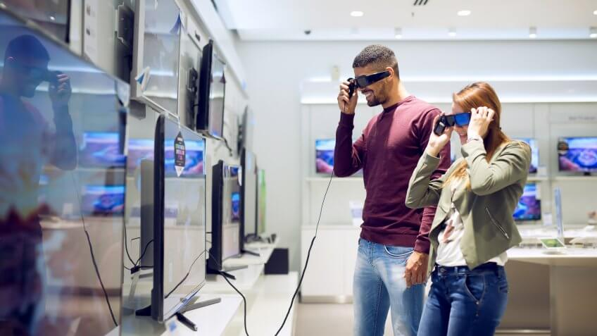couple testing out new 3d tv