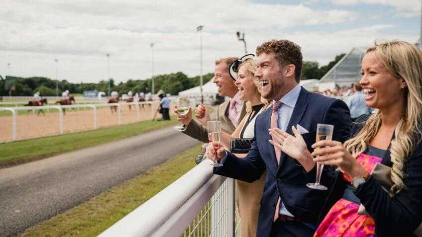 Couples enjoying a day at the races.