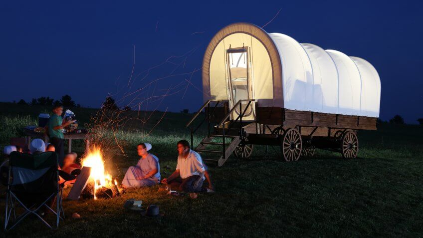 covered wagon next to camp fire