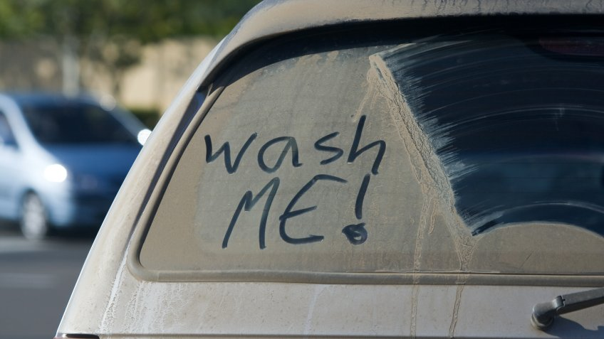 extremely dirty back windshield on car