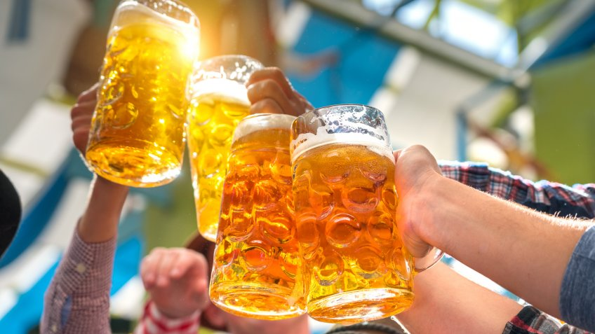 friends drinking beer cheers during Oktoberfest.
