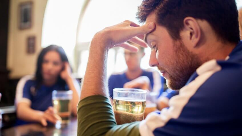 frustrated man with beer