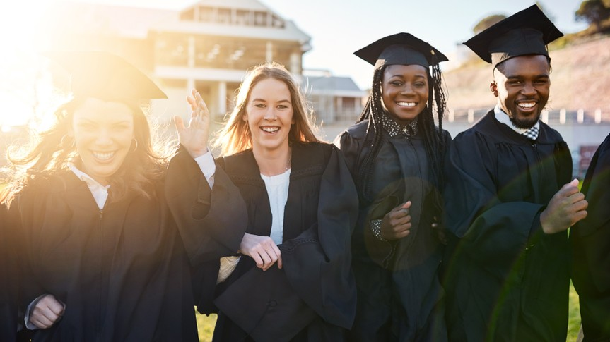 Portrait of a group of students standing together on graduation day.