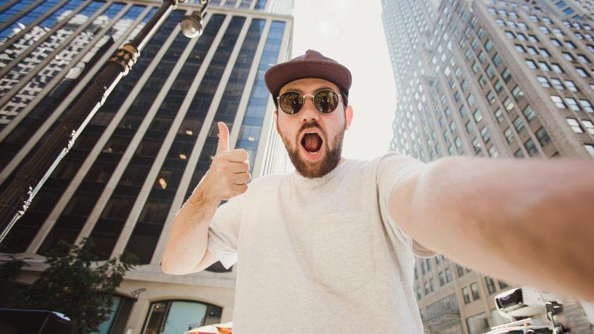 influencer taking selfie in city