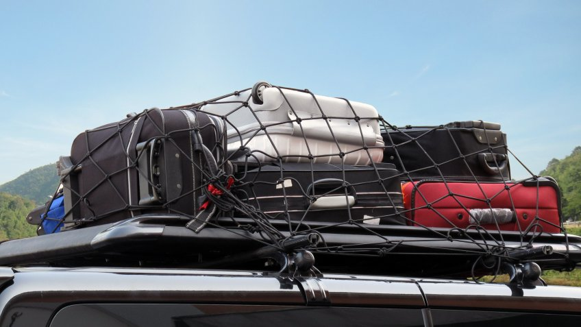 load of luggage on top of car