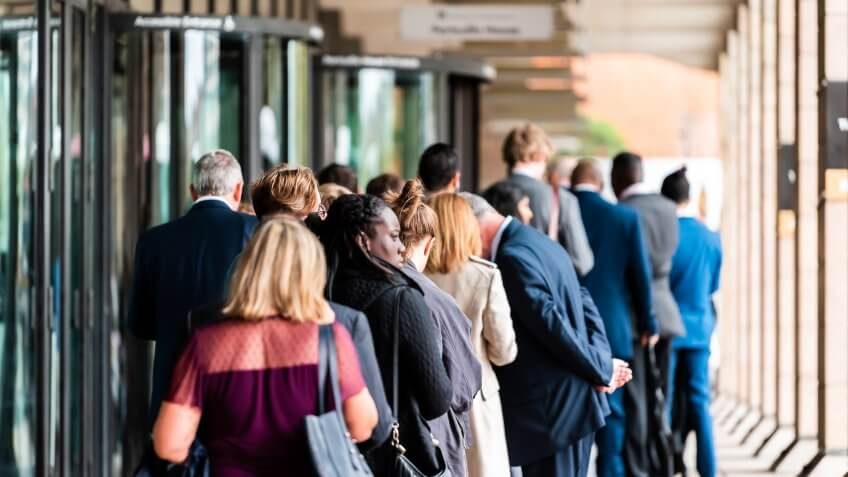 London, UK - September 12, 2018: People many crowd crowded standing in line queue to Westminster station cafe restaurant building on commute.