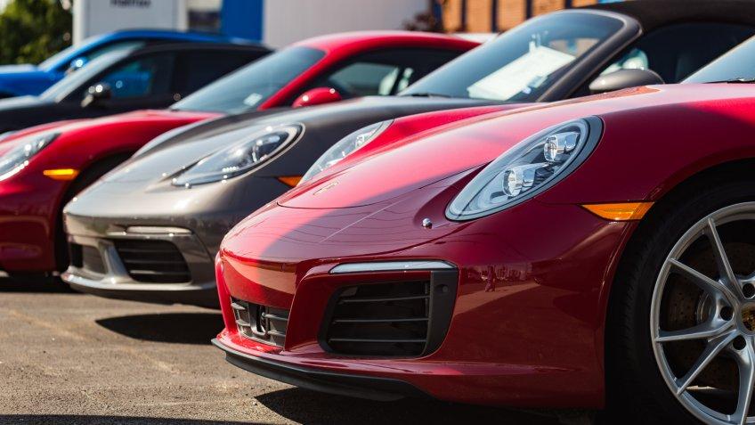 luxury Porsche car in dealership lot