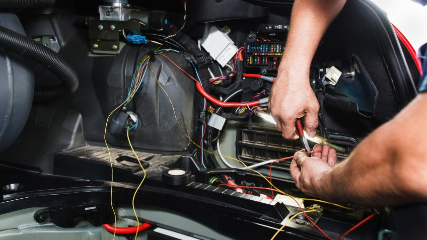mechanic checking electrical wires