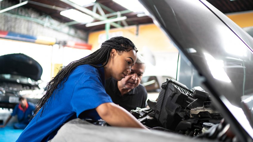 Mechanic partners in a auto repair shopu.