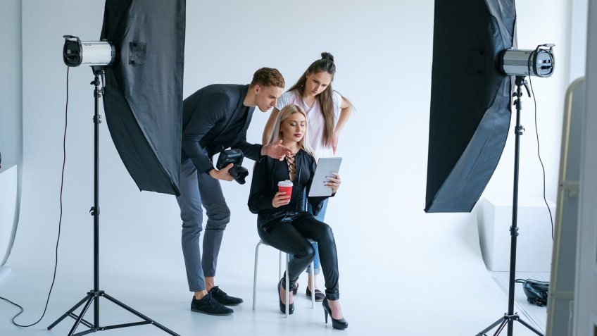model being directed by photographer in studio