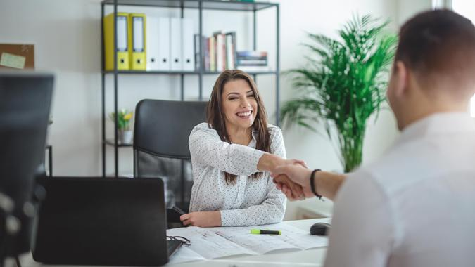 Young successful forewoman interviewing a job candidate at her office.
