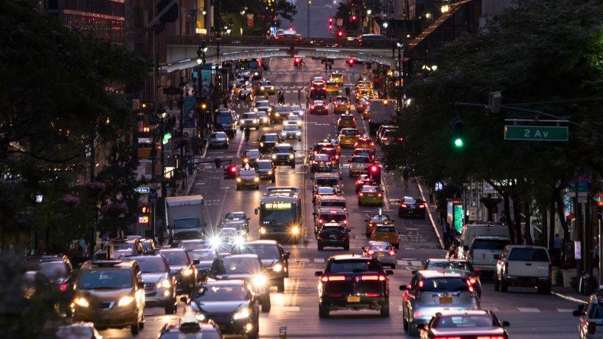 Lights from crosstown traffic on 42nd Street in Midtown Manhattan New York City.