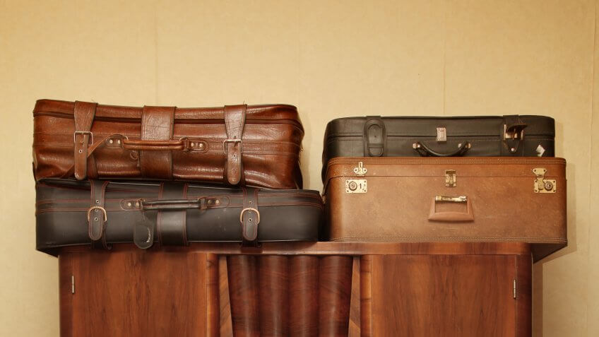 old brown suitcases.