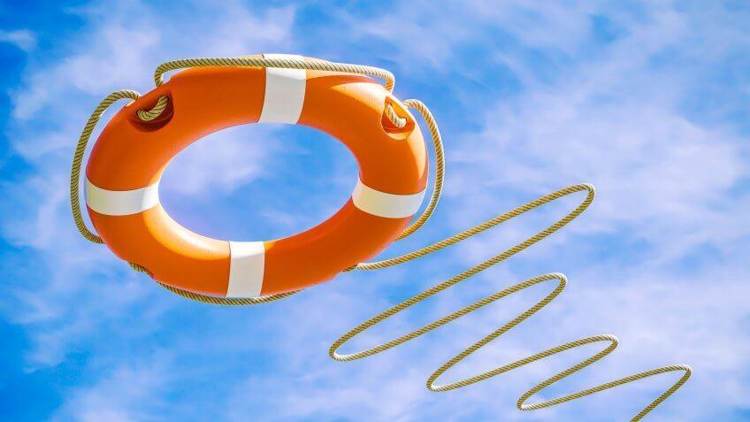 Orange lifebuoy on sky background.
