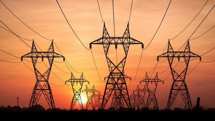 Electricity Pylons at sunset on background.