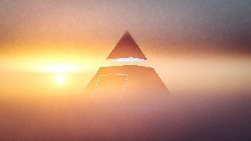 pyramid scheme concept at sunset