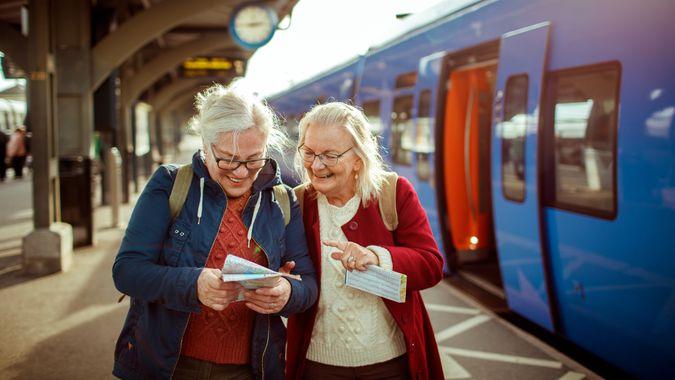 Close up of two seniors at a trainstation.