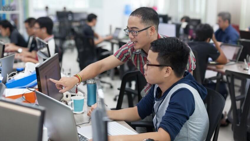 software application developers brainstorming on app