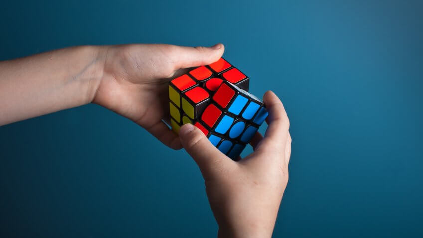 solving rubik's cube puzzle toy