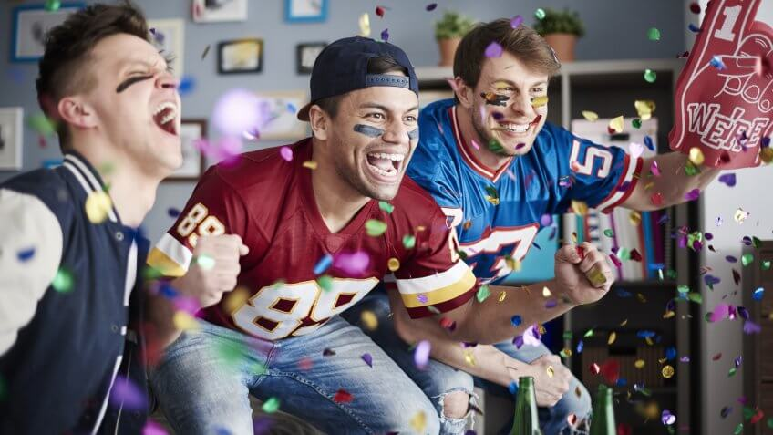 sports fans cheer after touchdown