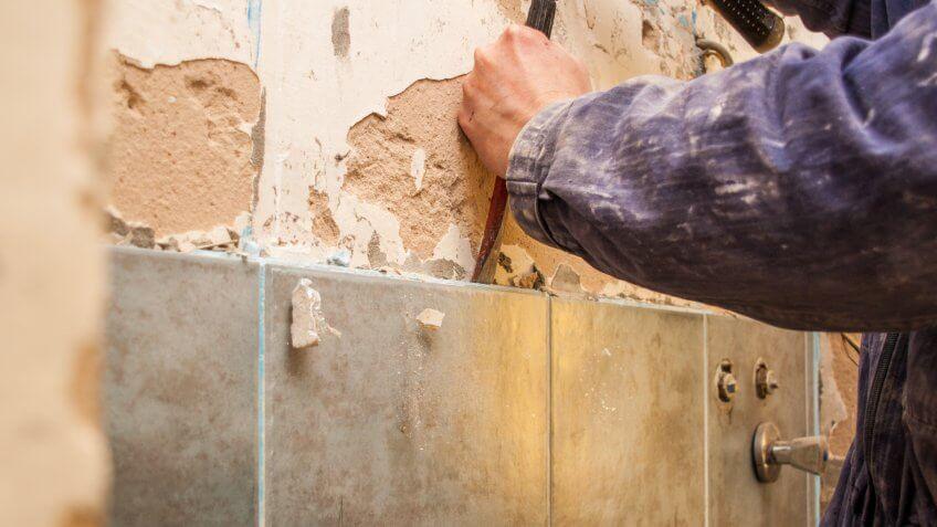 tile worker takes off bad tile