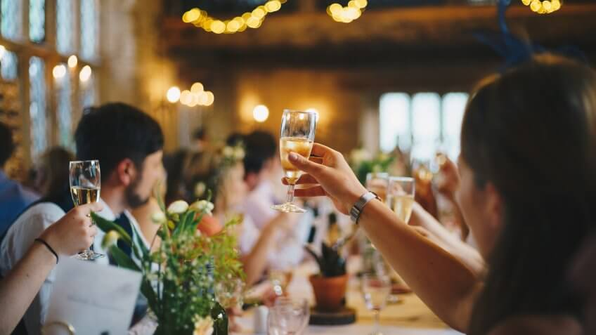 woman cheersing wedding party