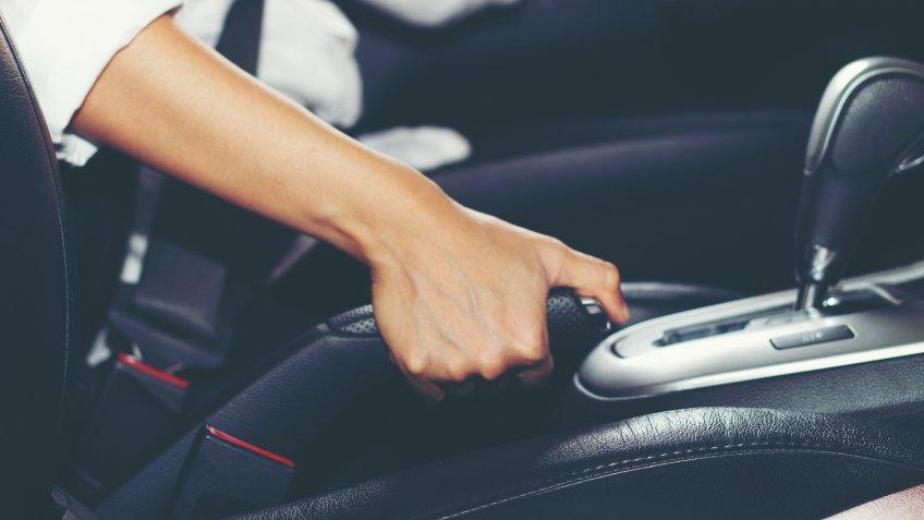 Asian women are the handbrake and Parking Brake car.