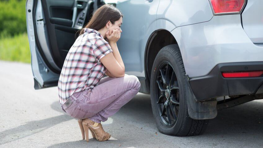 woman with flat tire