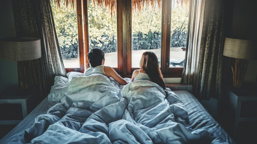 Couple love in bed on Holiday time Honeymoon vacation  summer concept.