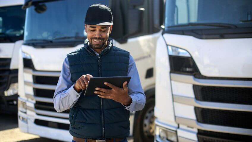 Truck driver using a tablet.