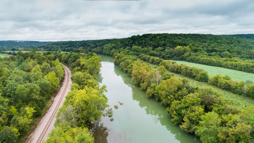 Aerial flight over the Spring River next to the BNSF railroad in Hardy, Arkansas - Image.