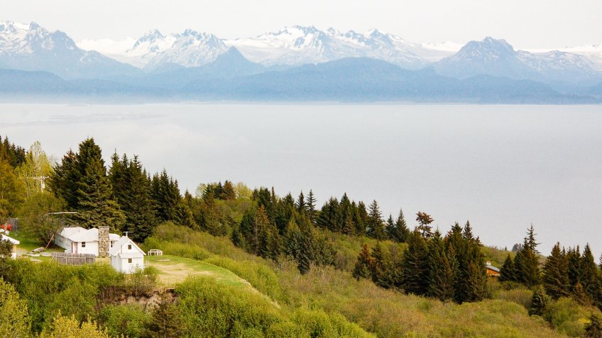 The scenery of Anchor Point with the faraway Katmai National Park and Preserve on the background along the Sterling highway to Homer in Alaska.