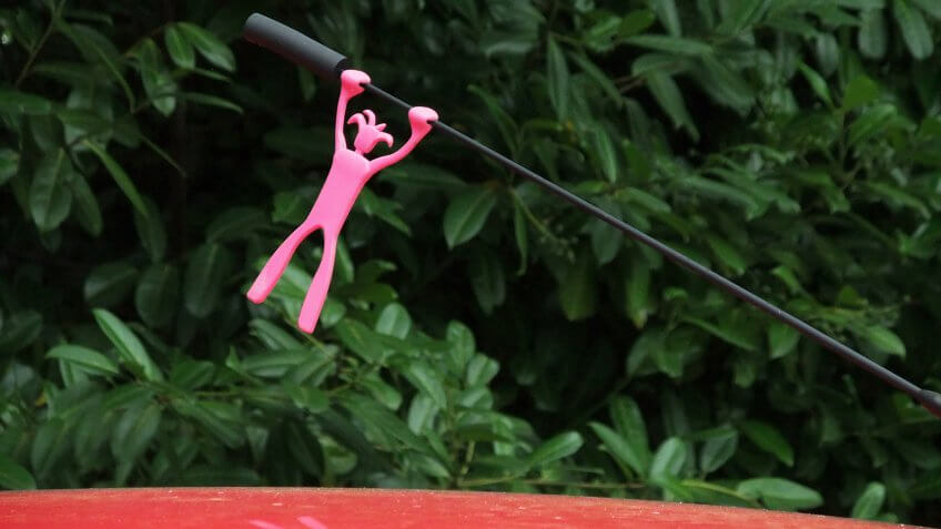 Car Aerial Topper, figure holding on by its hands - Image.