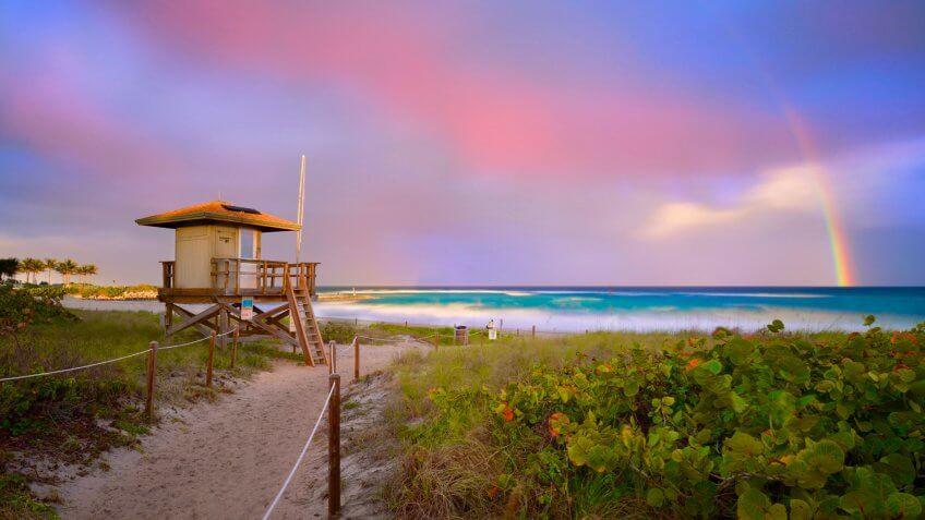 Beautiful Sunset with rainbow at Boca Raton beach, Florida - Image.